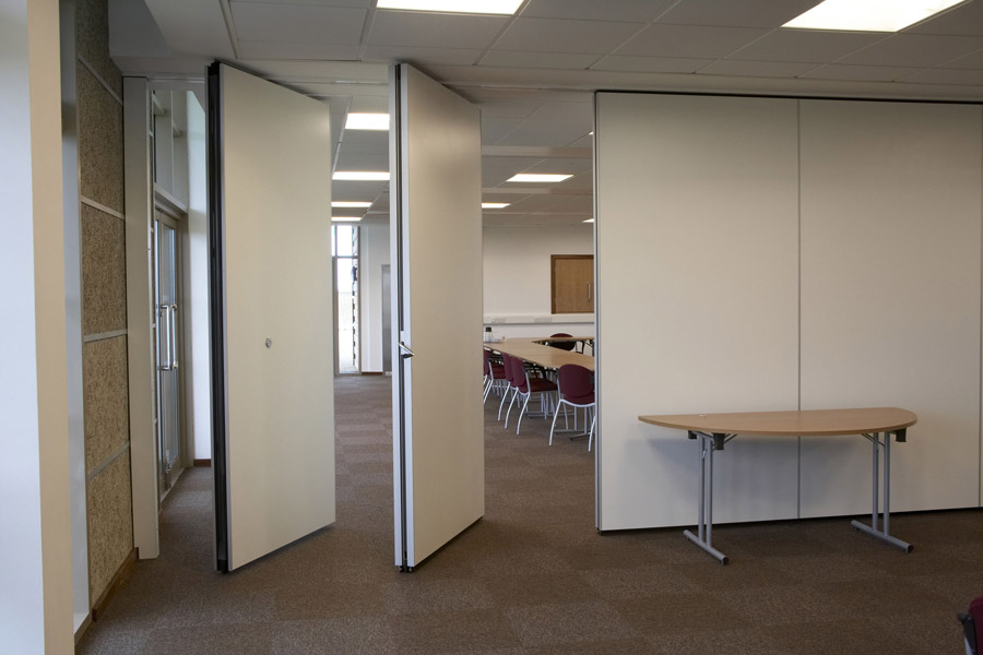 Folding partitioning unique fitout tel 021 4822656 for Retractable walls commercial